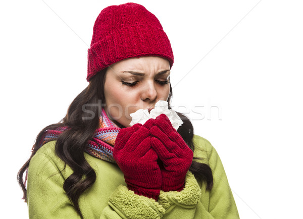 Sick Mixed Race Woman Blowing Her Sore Nose with Tissue