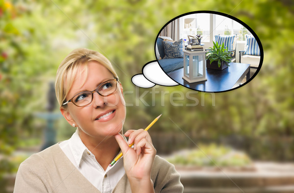 Thoughtful Young Woman with Pencil and New Living Room in Though Stock photo © feverpitch