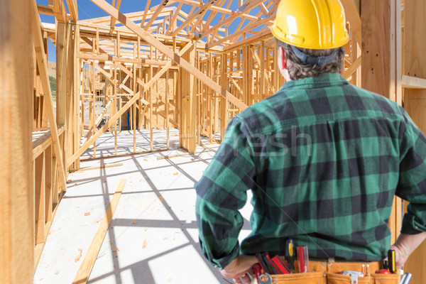 Contractor Standing Inside Construction Framing of New House. Stock photo © feverpitch