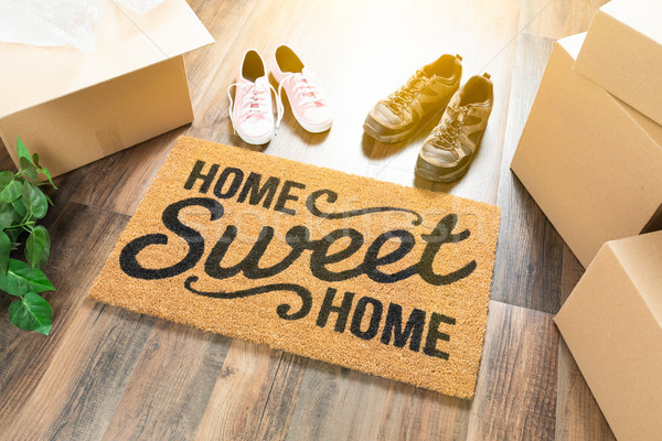 Home Sweet Home Welcome Mat, Moving Boxes, Women and Male Shoes  Stock photo © feverpitch