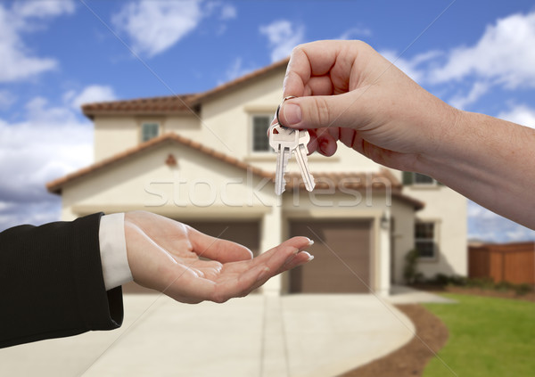 Stock photo: Handing Over the House Keys in Front of New Home