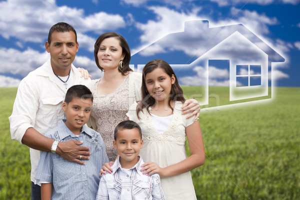 Hispanic Family Standing in Grass Field with Ghosted House Behin Stock photo © feverpitch