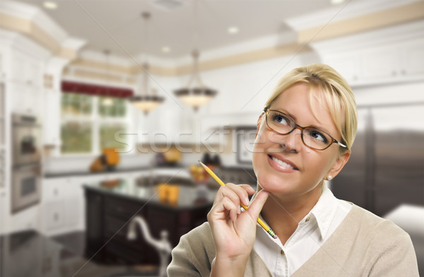 Daydreaming Woman with Pencil Inside Beautiful Custom Kitchen Stock photo © feverpitch