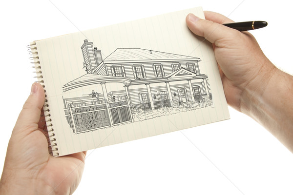 Hands Holding Pen and Pad of Paper with House Drawing Stock photo © feverpitch