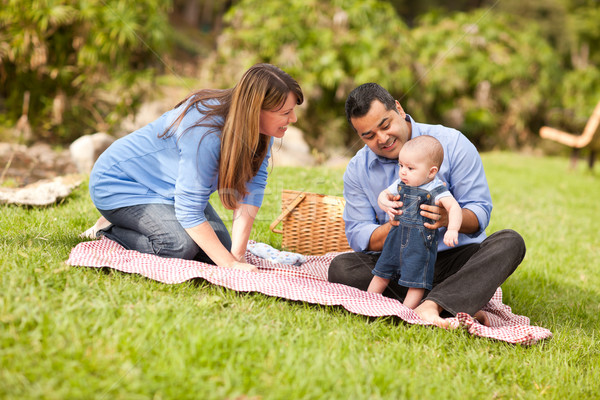 Stock photo: Happy Mixed Race Family Playing In The Park