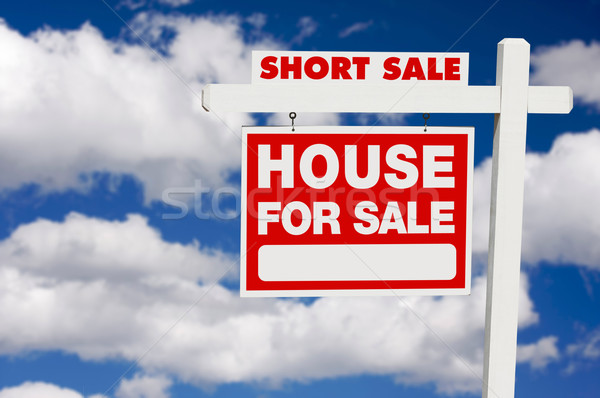 Short Sale Real Estate Sign on Clouds Stock photo © feverpitch