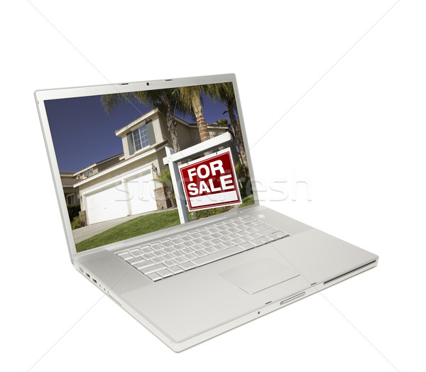 Home for Sale Sign & New House on Laptop Stock photo © feverpitch