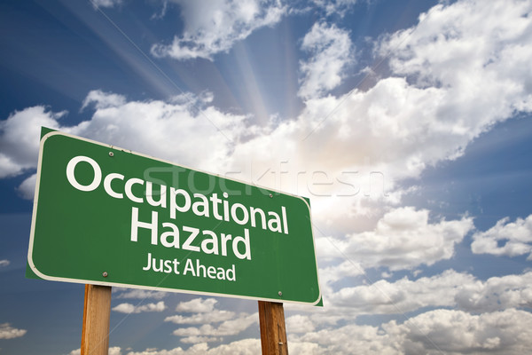 Occupational Hazard Green Road Sign Over Clouds Stock photo © feverpitch