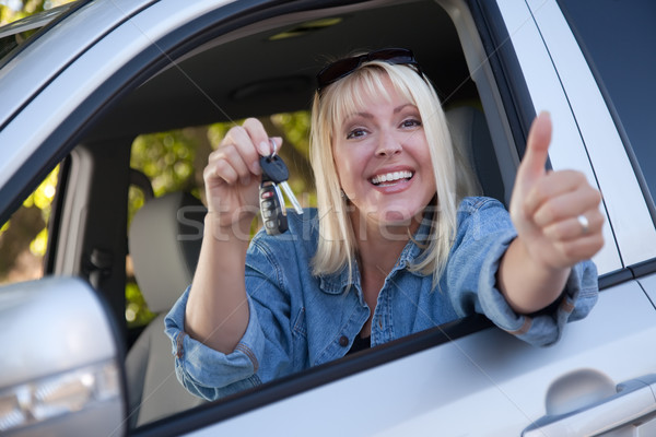 Stock photo: Attractive Woman In New Car with Keys
