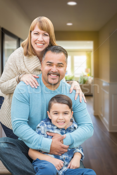 Mixed Race Family Portrait Inside Their New House. Stock photo © feverpitch