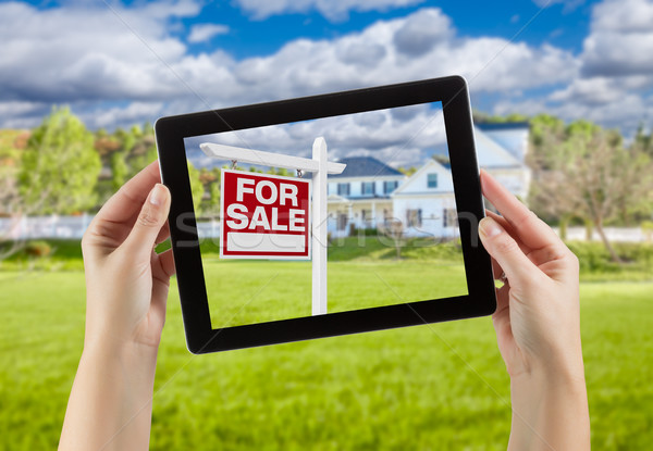 Female Hands Holding Computer Tablet with Home For Sale Sign on  Stock photo © feverpitch