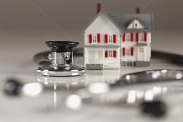 Stethoscope with Small Model Home Stock photo © feverpitch