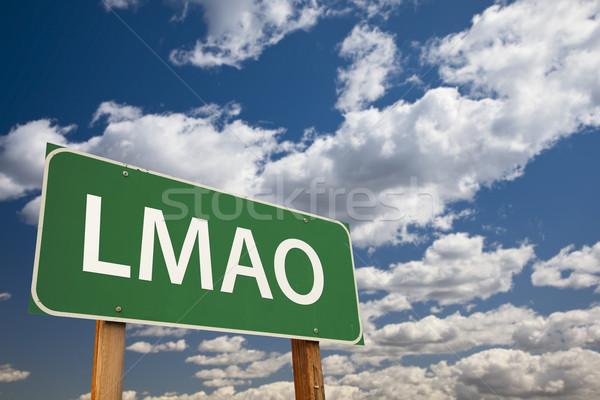 Verde cartello stradale cielo abbreviazione ridere Foto d'archivio © feverpitch