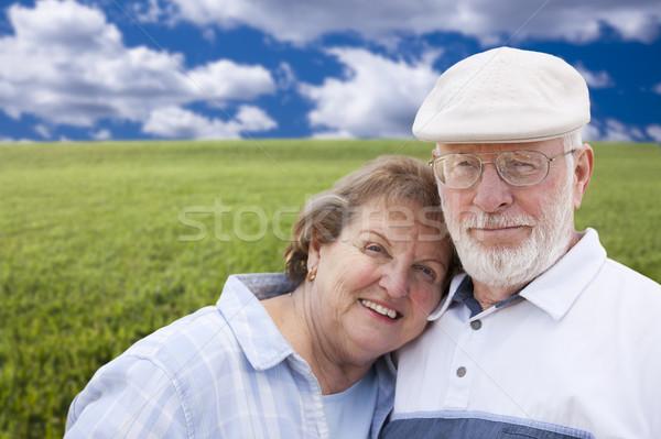 Stock photo: Loving Senior Couple Standing in Grass Field