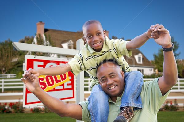 Apa fia ingatlan felirat otthon boldog afroamerikai Stock fotó © feverpitch