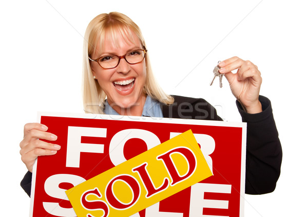 Attractive Blonde Holding Keys & Sold For Sale Sign Stock photo © feverpitch