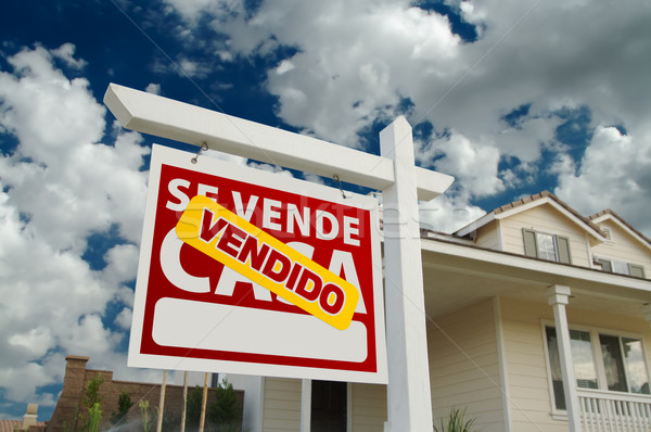 Vendido Se Vende Casa Spanish Real Estate Sign and House Stock photo © feverpitch