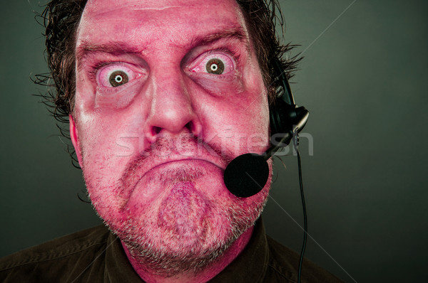Grumpy Red Eyes and Face Customer Support Man with Headset Stock photo © feverpitch