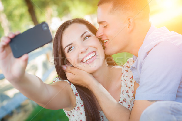 Happy Mixed Race Couple Taking Self Portrait with A Smart Phone  Stock photo © feverpitch
