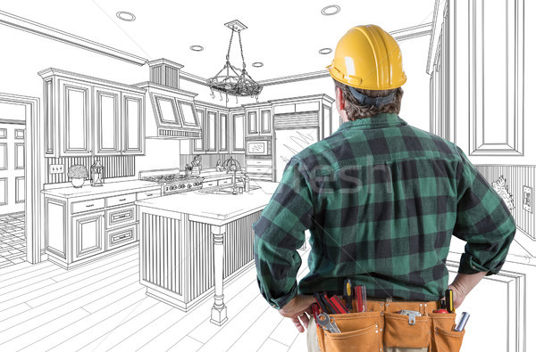 Male Contractor with Hard Hat and Tool Belt Looking At Custom Ki Stock photo © feverpitch