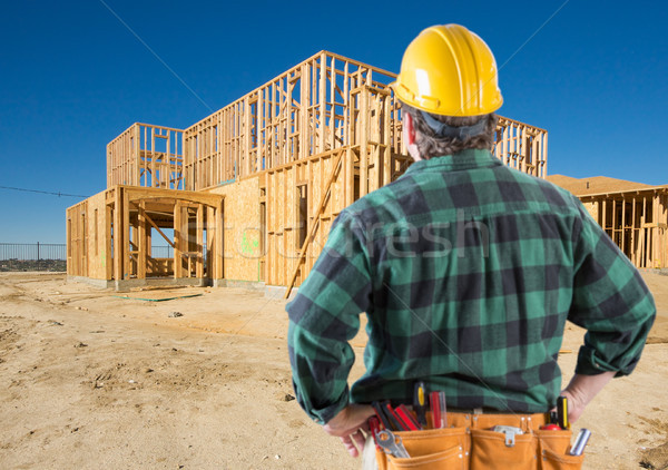 Contractor with Hard Hat Looking At New House Framing at Constru Stock photo © feverpitch