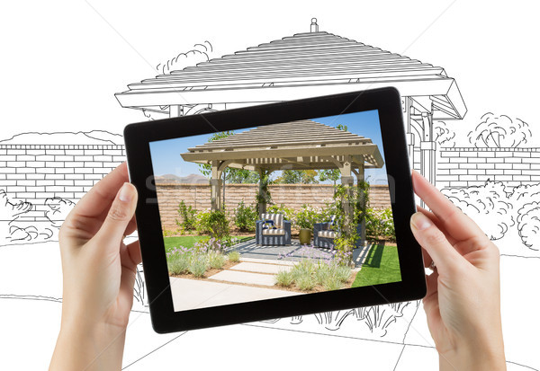 Female Hands Holding Computer Tablet with Photo of Pergola on Sc Stock photo © feverpitch