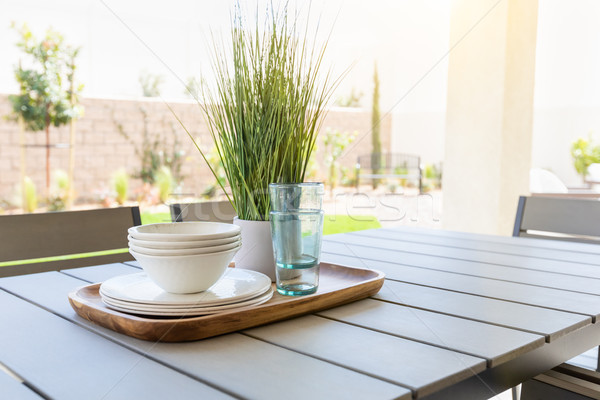 Outdoor Patio Setting with Dishes and Glasses on Tray Stock photo © feverpitch
