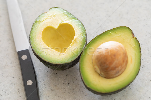 Fresh Cut Avocado With Heart Shaped Pit Area On Wooden Cutting B Stock photo © feverpitch