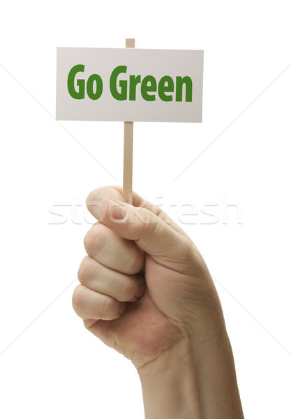 Go Green Sign In Fist On White Stock photo © feverpitch