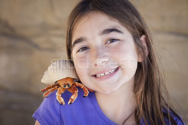 Young Girl Playing with Toy Hermit Crab Stock photo © feverpitch