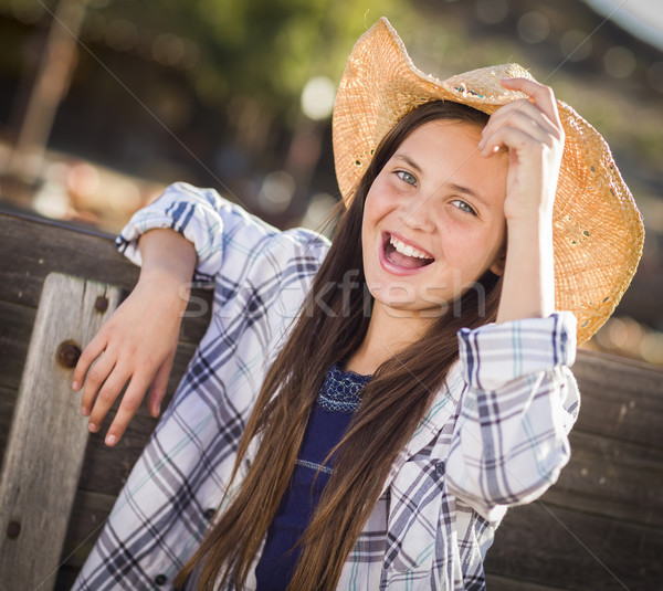 Menina retrato abóbora chapéu de cowboy Foto stock © feverpitch