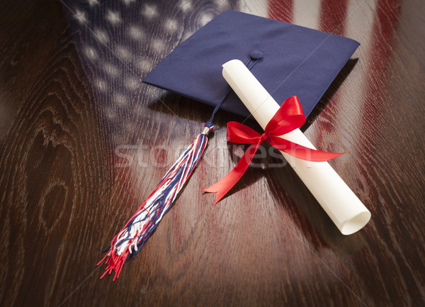 Graduation Cap and Diploma on Table with American Flag Reflection Stock photo © feverpitch