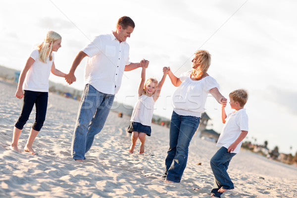Adorable Little Girl Swinging with Her Parents Stock photo © feverpitch