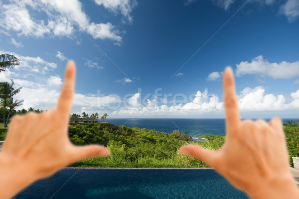 Hands Framing Breathtaking Hawaiian Ocean View Deck and Pool Stock photo © feverpitch