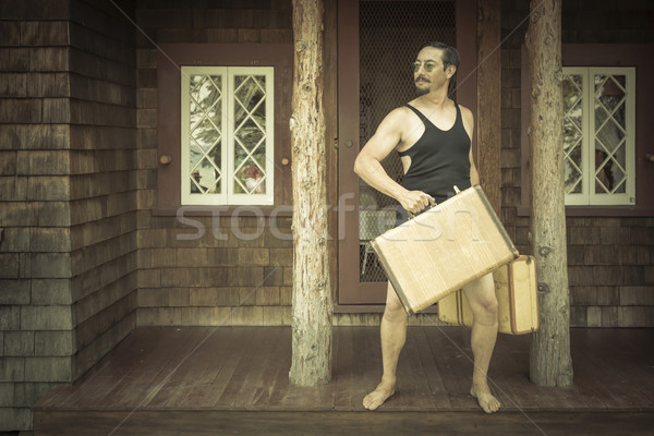 Gentleman Dressed in 1920's Era Swimsuit Holding Suitcases on  Stock photo © feverpitch