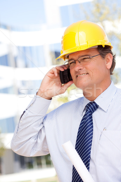 Contractor in Hardhat and Necktie Talks on His Cell Phone Stock photo © feverpitch