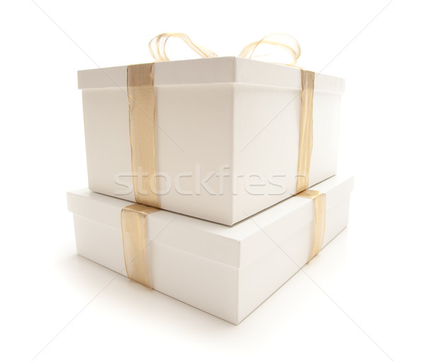 Stacked White Gift Boxes with Gold Ribbon Isolated Stock photo © feverpitch