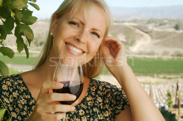 Attractive Woman Sips Wine Stock photo © feverpitch