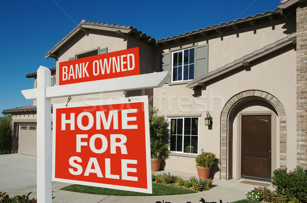 Bank Owned Home For Sale Sign in Front of New House Stock photo © feverpitch