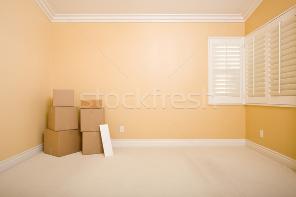 Stock photo: Moving Boxes and Blank Sign in Empty Room