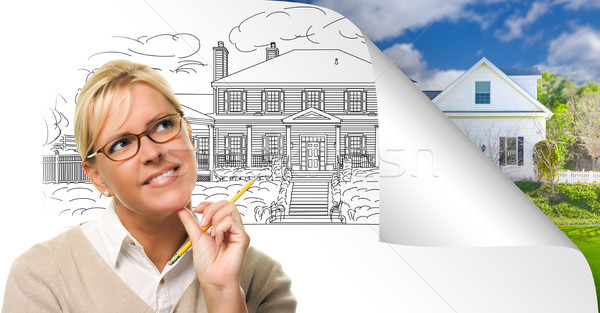 Woman Facing House Drawing Page Corner Flipping with Photo Behin Stock photo © feverpitch