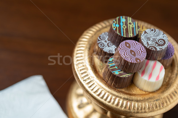 Artisan Fine Chocolate Candy On Gold Pillar Serving Dish Stock photo © feverpitch