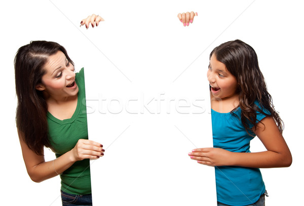 Pretty Hispanic Girl and Mother Holding Blank Board Stock photo © feverpitch