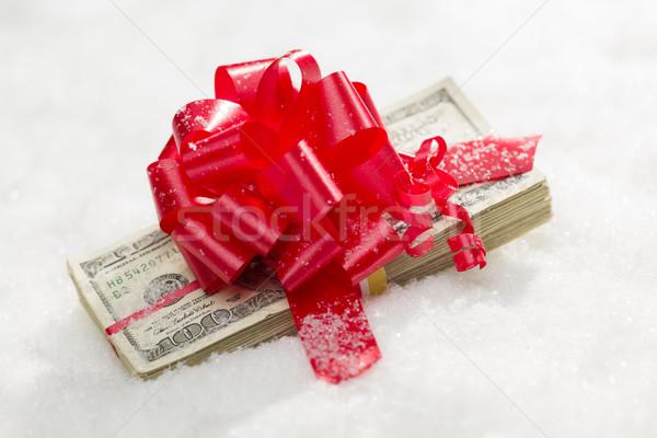 Boglya száz dollár bankjegyek vörös szalag hó egy Stock fotó © feverpitch