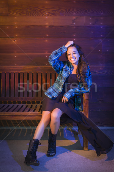 Mixed Race Young Adult Woman Portrait Sitting on Wood Bench Stock photo © feverpitch