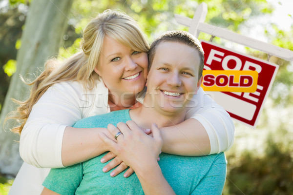Happy Couple In Front Sold Real Estate Sign Stock photo © feverpitch