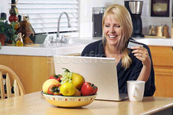 Woman Using Laptop for E-commerce Stock photo © feverpitch