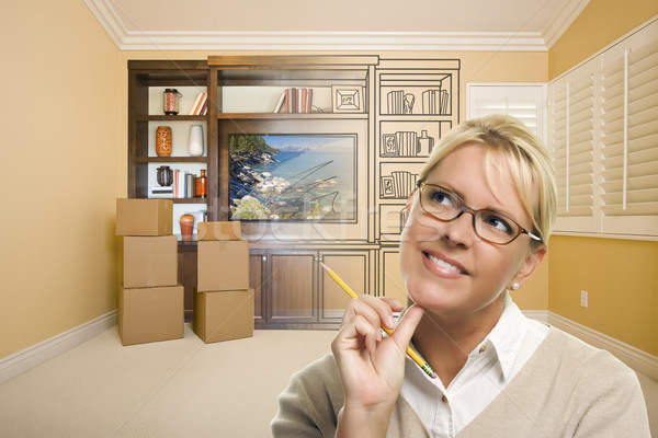 Female Holding Pencil In Room With Drawing of Entertainment Unit Stock photo © feverpitch