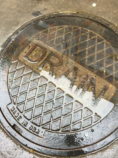 Stock photo: Industrial Wet Street Drain Cover