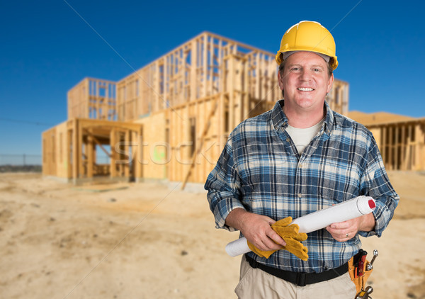 Contractor with Plans and Hard Hat In Front of New House Framing Stock photo © feverpitch